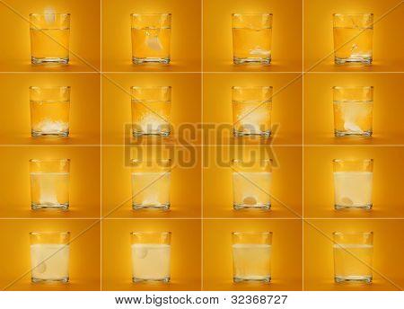 Aspirin in glass of water.