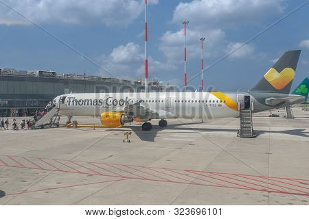 Naples, Italy - July 19 2019: Thomas Cook Airbus A 321 Taxied On Airport Runway Tarmac With Boarding