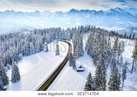 Winter In Mountains. Mountain Hills Covered With Snow. Winter Landscape With Road.