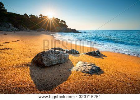 Summer Seascape. Beach With Golden Beach At Sunset. Cala Boadella Beach, Spain.