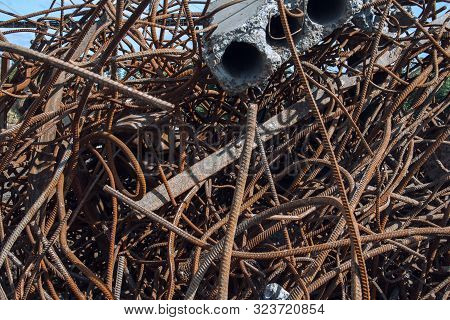 Industrial background. Rebar texture. Old rusty rebar for concrete pouring. Steel reinforcement bars. Dismantled construction rebar steel work reinforcement. Closeup of Steel rebars. poster