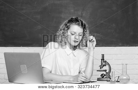 Microbiology Concept. Student Girl With Laptop And Microscope. Molecular Biology Phd Projects. Scien