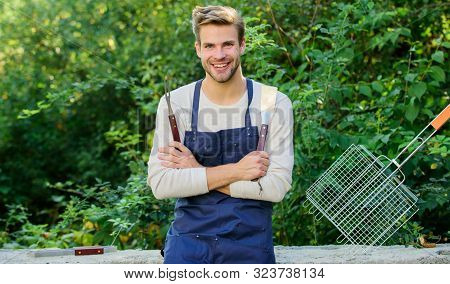 Just For Fun. Culinary Concept. Chef Cooking Bbq Food. Tools For Roasting Meat Outdoors. Family Week