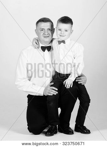 tuxedo style. happy child with father. business meeting party. little boy with dad businessman. family day. esthete. male fashion. father and son in formal suit. Real happiness. childhood happiness poster