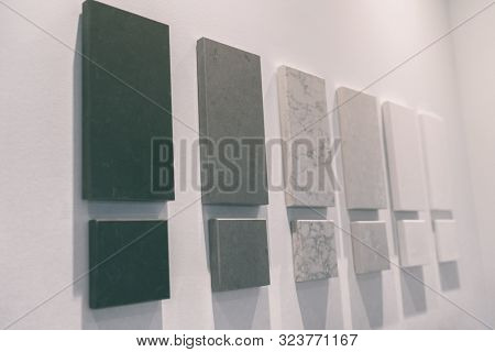 Kitchen countertop quartz samples at home improvement interior design store or condo project showroom office. House remodeling renovation colors of solid surfaces countertops stones.