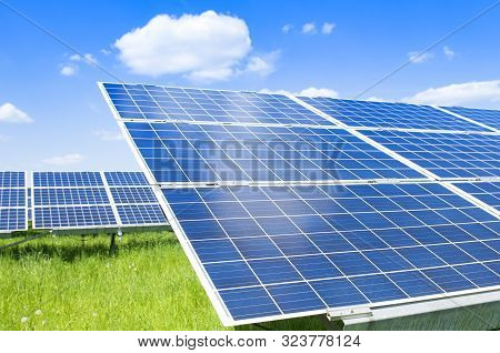 Solar Panels And Blue Sky. Solar Panels System Power Generators From Sun. Clean Technology For Bette