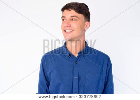 Face Of Happy Young Handsome Businessman Thinking And Looking Up