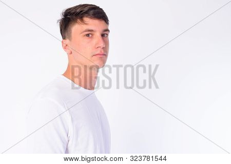 Closeup Profile View Of Young Handsome Man Looking At Camera