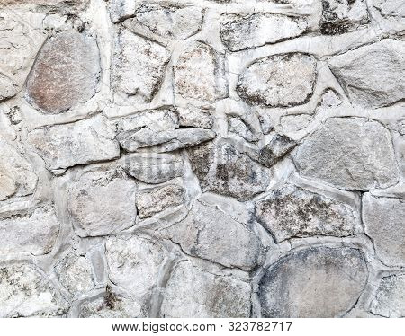 Wall Of Stone Blocks As An Abstract Background.