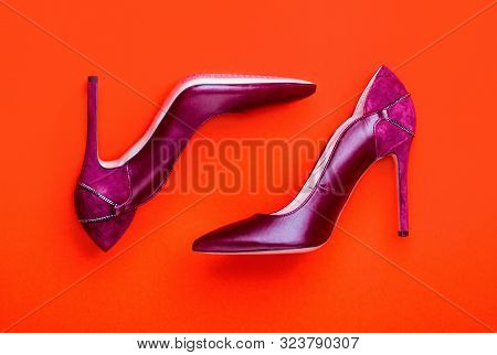 Red Shoe For Women. Beauty And Fashion Concept. Fashionable Women Shoes Isolated On Red Background.