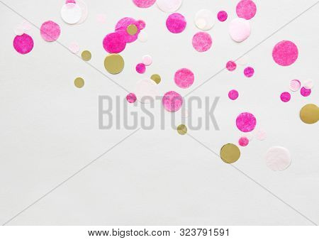 White Festive Background With Pink Confetti. Christmas Holiday Background. Flat Lay