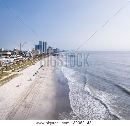 Aerial view of tourist area, beach, and hotels in Myrtle Beach, South Carolina.