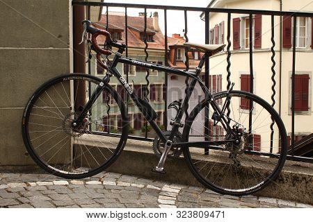 Lausanne, Switzerland - July 29, 2019: A Croix De Fer Genesis Bike Parked In The Ancient Center Of L