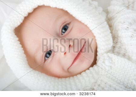 Baby In White Hood