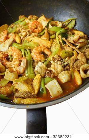 Stir Fried Spicy Curry With Shrimp, Squid And Pork Or Pad Prik Kang In Thai.