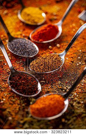 Spices In Spoons. Still Life Of Spices And Herbs