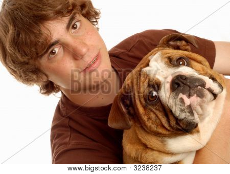 attractive fourteen year old boy and his pet bulldog puppy poster