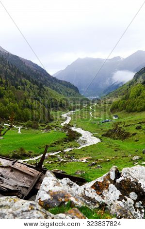 French Pyrenean Landscape With Stream In Valley