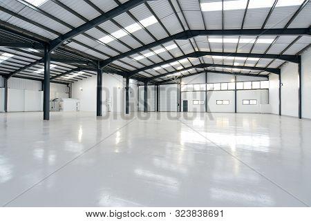 An Empty Warehouse Unit With Shiny Floor