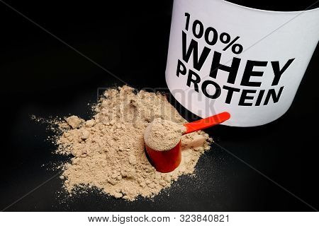 Whey Protein Powder In Measuring Scoop. Bodybuilding Nutrition Supplements.
