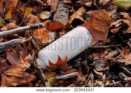 Plastic and glass bottles thrown away and left in nature, pile of garbage. Ecological, ecology, recycling industry, not ecology, recycled material, pollution, neglect, environmental protection. poster