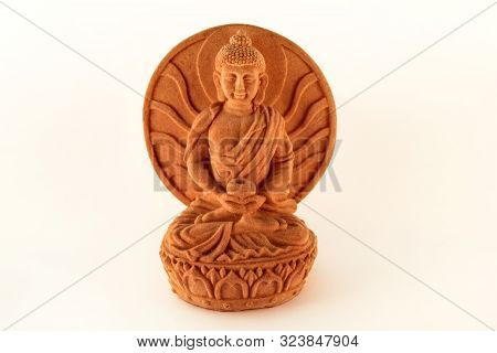 poster of Figurine sitting statue healing Buddha isolated on white background / Tibetan and indian medicine Buddha.