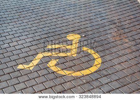 Post With Disabled Parking Space And Sign In Front Of Parking Bay In Car Park / Marked Parking For P