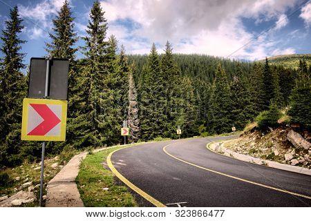 Transalpina Road curve warning sign, Romania