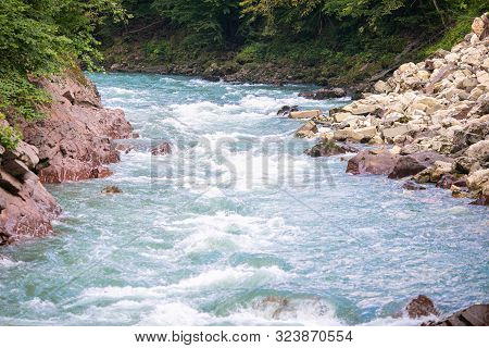 A Beautiful River Flows Between The Rocks