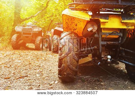 Atv In The Forest, In The Mud. Wheels And Atv Elements Close-up In The Mud. Active Leisure, Sports A