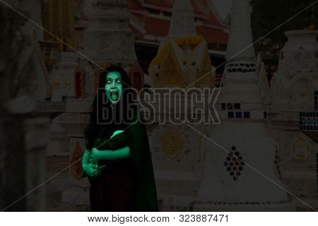Ancient Thai Ghost In Traditional Costume That Appear In History. The Uniqueness Of The Dress Of Tha