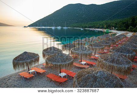 Summer Sunny Morning Sunbeds And Umbrellas Of Amazing Antisamos Beach On The Kefalonia Island, Ionia