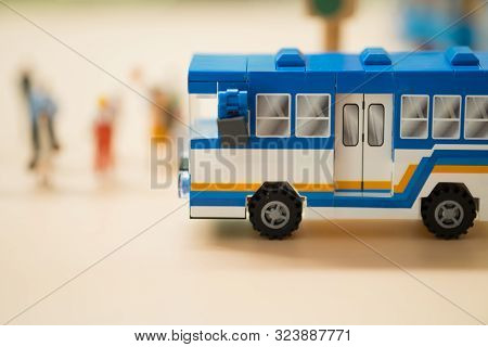 Miniature Toy Bus. People Travel By Bus In Bangkok. Buses Are One Of The Most Important Public Trans