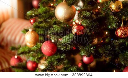 Beautiful Photo Of Decorated Christmas Tree Woth Colorful Baubles, Beads And Garlands At House Livin