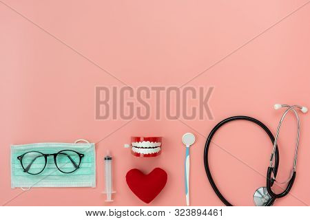 Table Top View Aerial Image Of Accessories Healthcare & Medical Background.red Heart & Denture Tools