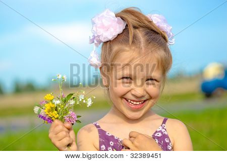 Happy smiling girl with flowers