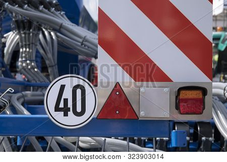 Road Sign On A Plow Trailer Speed Limit To 20 Km Per Hour Close Up
