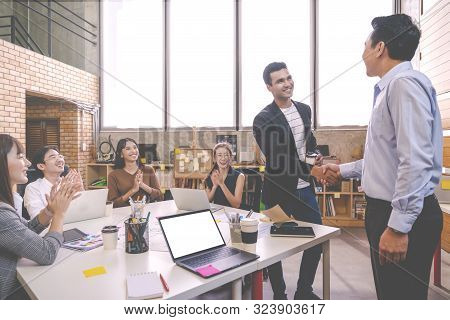 Candid Of Indian Creative Design Man Smiling And Shaking Hands With Coworker Man Or Colleague And Ot