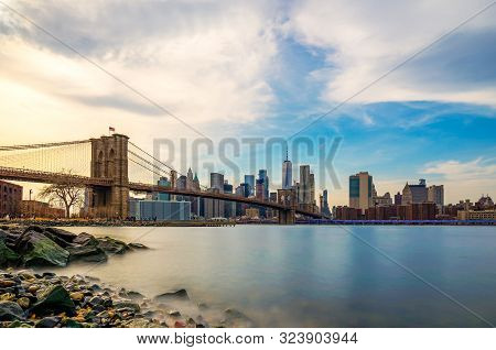 Beautiful Sence Of Brooklyn Bridge And Lower Manhattan Of New York City In Dusk Evening. Downtown Of