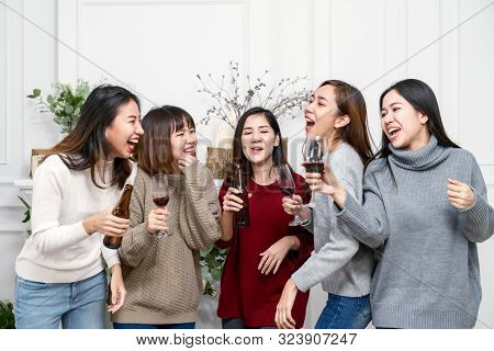 Young Attractive Woman Asian Group Of Friend Drinking, Laughing And Fun With Happy In Gathering Reun