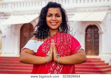 Young Indian Woman In Traditional Sari Red Dress Praying In A Hindu Temple Goa India Hinduism.girl P