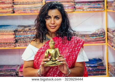 Business Lady Indian Seller Tradition Red Sari Souvenir Shop Buddha Shiva Figurine Yoga Meditation.g