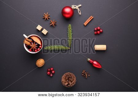 A Clock In The Form Of Spice For Mulled Wine. Cinnamon, Anise Stars, Cranberries, Brown Sugar. Conce