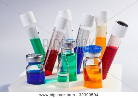 Many multicolor test tubes and bottles medical still life poster
