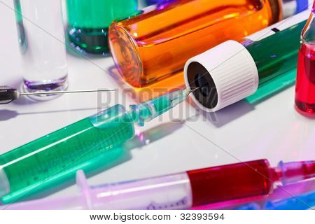 Syringe and test tube macro medical still life