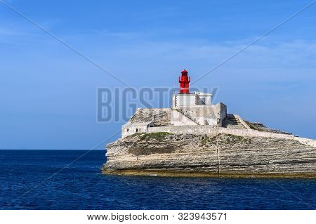 Bonifacio, Corsica - September , 2019. Little Red Old Lighthouse On A Rock Near Bonifacio Corsica