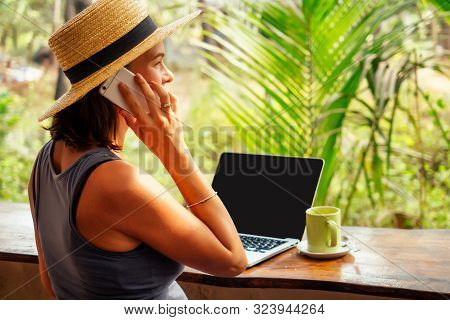 Technology And Travel. Working Outdoors. Freelance Concept. Pretty Young Woman In Hat Using Laptop I