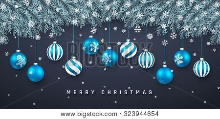 Festive Christmas Or New Year Background. Christmas Fir-tree Branches With Confetti And Xmas Blue Ba