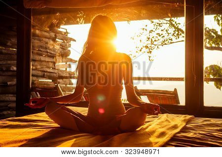 Woman Sun Rays In The Form Of Chakras In Tropical Yoga Studio A View Outside To The Hills While Suns