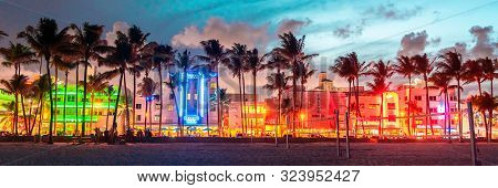 Miami Beach, Usa - September 10, 2019: Ocean Drive Hotels And Restaurants At Sunset. City Skyline Wi